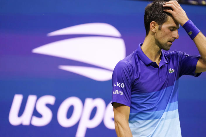 Novak Djokovic, of Serbia, reacts during his match against Jenson Brooksby, of the United States, during the fourth round of the U.S. Open tennis championships, Monday, Sept. 6, 2021, in New York. (AP Photo/John Minchillo)