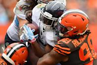 Dion Lewis #33 of the Tennessee Titans is met at the line of scrimmage by Sheldon Richardson #98 of the Cleveland Browns in the first quarter at FirstEnergy Stadium on September 08, 2019 in Cleveland, Ohio. (Photo by Jamie Sabau/Getty Images)
