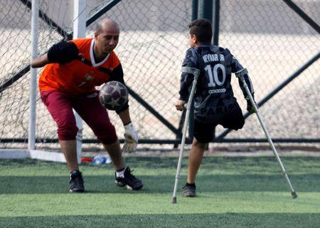 """Nour Eldin Ahmed, 12, a member of """"Miracle Team"""", a soccer team made up of one-legged, crutch-bearing soccer players, attends a training session at El Salam club on the outskirts of Cairo, Egypt December 29, 2017.  REUTERS/Amr Abdallah Dalsh"""