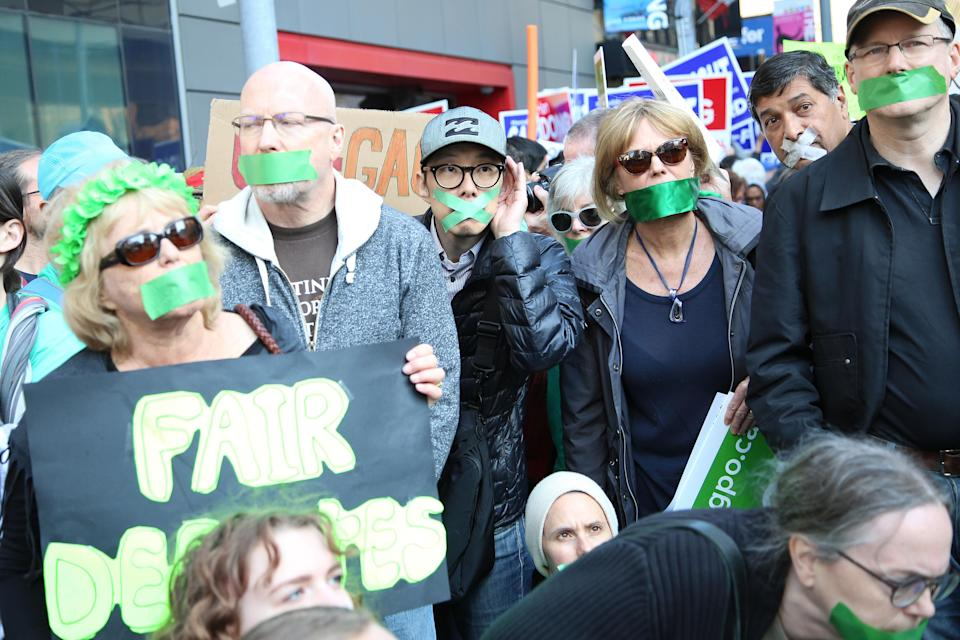 Green Party supporters arrived and had green tape on their mouths suggesting they are voiceless at the debate/Getty Images