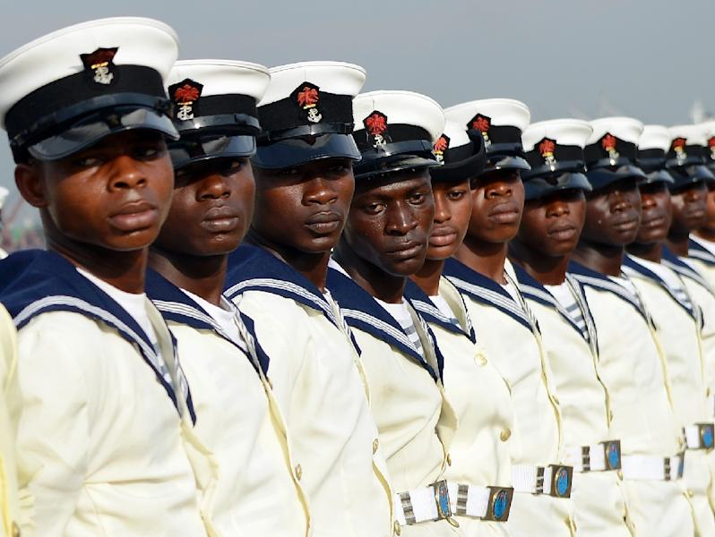 """Nigerian marines attend the commissioning ceremony of the """"NNS Centenary"""", an offshore patrol vessel built by Chinese Shipbuilding and Industry Corporation (CSIC) for Nigerian Navy, on February 19, 2015 in Lagos (AFP Photo/Pius Utomi Ekpei)"""