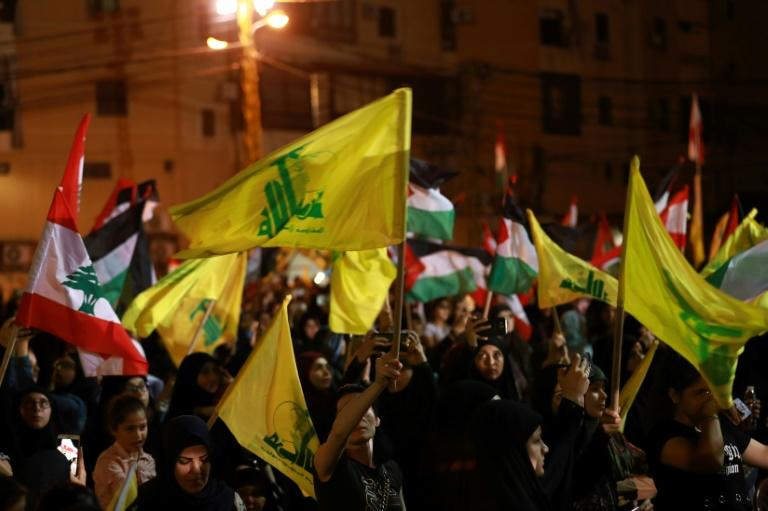 Lebanese supporters of the Shiite Hezbollah party wave Lebanese national and party (yellow) flags, as they march in Beirut in May (AFP Photo/Anwar AMRO)