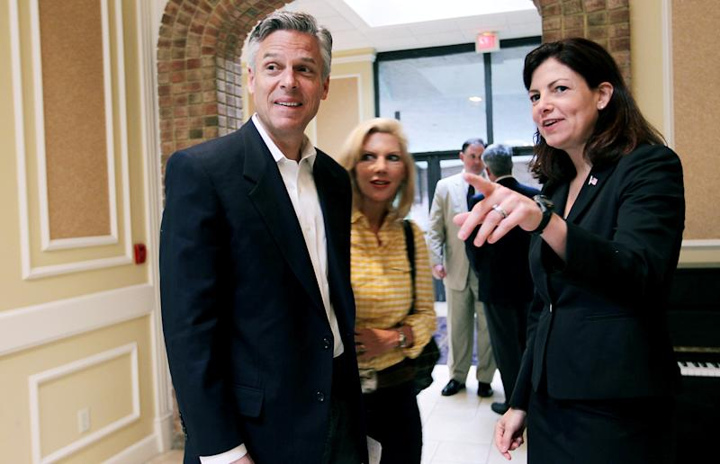 CORRECTS HUNTSMAN'S WIFE'S NAME TO MARY KAYE INSTEAD OF KAREN - Republican presidential hopeful, Former Utah Gov. Jon Huntsman, left, wife Mary Kaye, middle, and US Senator Kelly Ayotte, R-N.H., right, at the Department of New Hampshire VFW Annual Convention in Nashua, N.H., Saturday, June 11, 2011.  (AP Photo/Cheryl Senter)