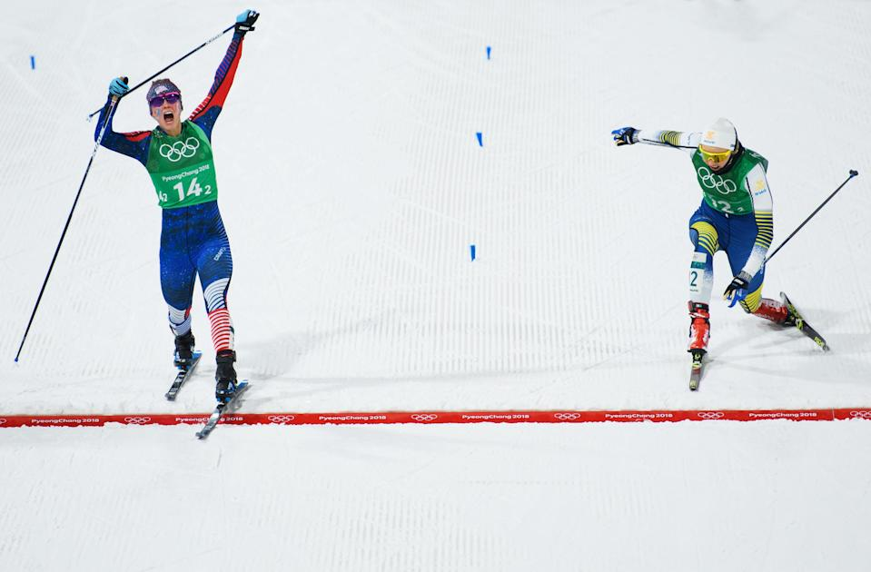Jessica Diggins of the United States (L) stretches across the finish line to win gold ahead of Stina Nilsson of Sweden during the Cross Country Ladies' Team Sprint Free Final on day 12 of the PyeongChang 2018 Winter Olympic Games. (Getty Images)