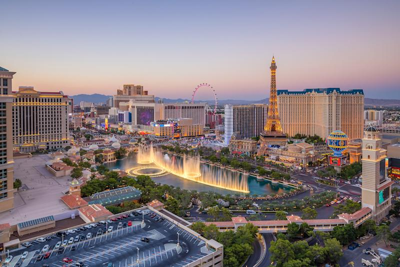 The Las Vegas Strip with a fountain and casinos filling the view