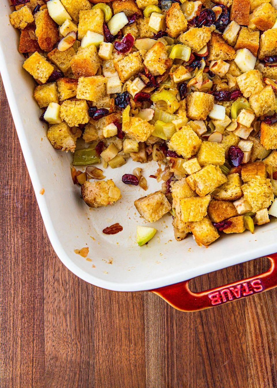 """<p>Your favorite fall fruit, now in a stuffing.</p><p>Get the recipe from <a href=""""https://www.delish.com/holiday-recipes/thanksgiving/a29492810/apple-stuffing-recipe/"""" rel=""""nofollow noopener"""" target=""""_blank"""" data-ylk=""""slk:Delish"""" class=""""link rapid-noclick-resp"""">Delish</a>.</p>"""