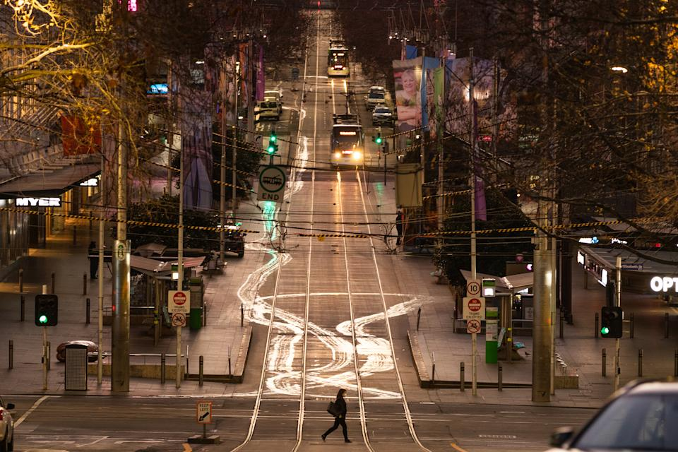 A general view of Bourke Street as a lone Pedestrian crosses the road on August 06, 2020 in Melbourne, Australia.