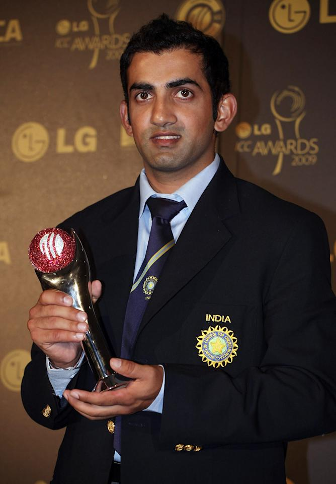 JOHANNESBURG, SOUTH AFRICA - OCTOBER 01:  Gautam Gambhir of India with the award for ICC Test Player Of The year at The ICC Awards 2009 held at The Sandton Convention Centre on October 1, 2009 in Johannesburg, South Africa.  (Photo by Julian Herbert/Getty Images)
