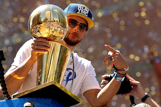 Jun 12, 2018; Oakland, CA, USA; Golden State Warriors guard Stephen Curry holds onto the Larry O'Brien Championship Trophy during the Warriors 2018 championship victory parade in downtown Oakland. Mandatory Credit: Cary Edmondson-USA TODAY Sports TPX IMAGES OF THE DAY