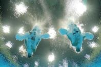 LONDON, ENGLAND - JULY 30: Ilya Zakharov (R) and Victor Minibaev of Russia compete during the Men's Synchronised 10m Platform Diving on Day 3 of the London 2012 Olympic Games at the Aquatics Centre on July 30, 2012 in London, England. (Photo by Adam Pretty/Getty Images)