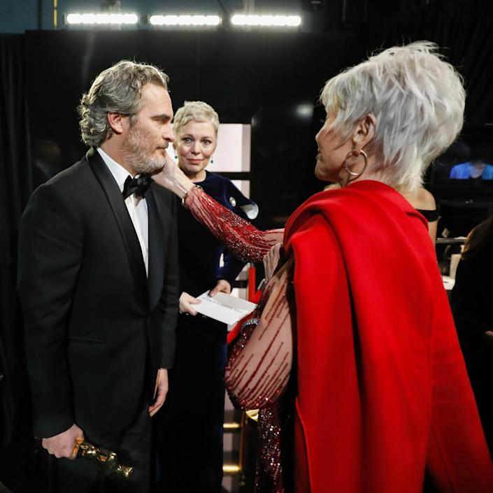 """2020: Jane Fonda caresses the face of Joaquin Phoenix, who won the lead actor Oscar for """"Joker,"""" backstage with Olivia Colman"""