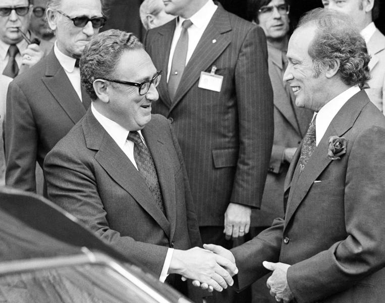 Pierre Trudeau (right), seen here greeting U.S. Secretary of State Henry Kissinger in 1974, governed Canada as part of a minority government in the early 1970s. His son Justin may find himself in a similar situation.