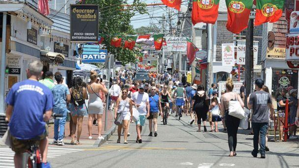 PHOTO: People walk on Commercial Street in Provincetown, Mass., on June 27, 2021. (Merrily Cassidy/Cape Cod Times via USA Today Network, FILE)