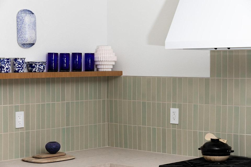 AFTER: The subtle green Heath tile adds a hint of color to the neutral counters and floors.
