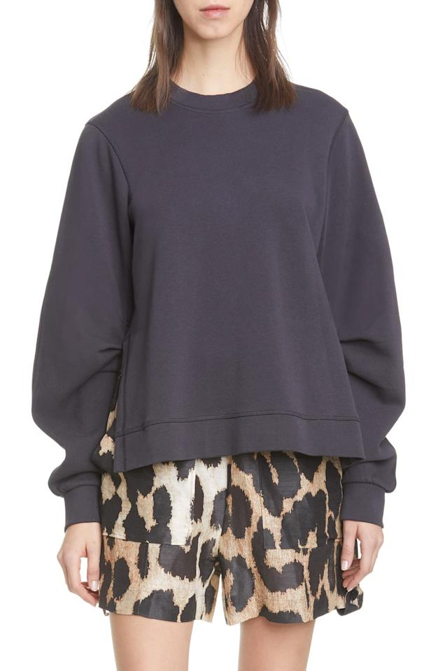 """<p>We're really digging this <a href=""""https://www.popsugar.com/buy/Ganni-Isoli-Oversize-Cotton-Sweatshirt-559061?p_name=Ganni%20Isoli%20Oversize%20Cotton%20Sweatshirt&retailer=shop.nordstrom.com&pid=559061&price=185&evar1=fab%3Aus&evar9=45619388&evar98=https%3A%2F%2Fwww.popsugar.com%2Ffashion%2Fphoto-gallery%2F45619388%2Fimage%2F47330072%2FGanni-Isoli-Oversize-Cotton-Sweatshirt&list1=shopping%2Csweaters%2Cwinter%2Csweatshirts%2Cwinter%20fashion%2Cathleisure&prop13=mobile&pdata=1"""" rel=""""nofollow"""" data-shoppable-link=""""1"""" target=""""_blank"""" class=""""ga-track"""" data-ga-category=""""Related"""" data-ga-label=""""https://shop.nordstrom.com/s/ganni-isoli-oversize-cotton-sweatshirt/5558930/full?origin=keywordsearch-personalizedsort&amp;breadcrumb=Home%2FAll%20Results&amp;color=phantom%20252"""" data-ga-action=""""In-Line Links"""">Ganni Isoli Oversize Cotton Sweatshirt</a> ($185).</p>"""