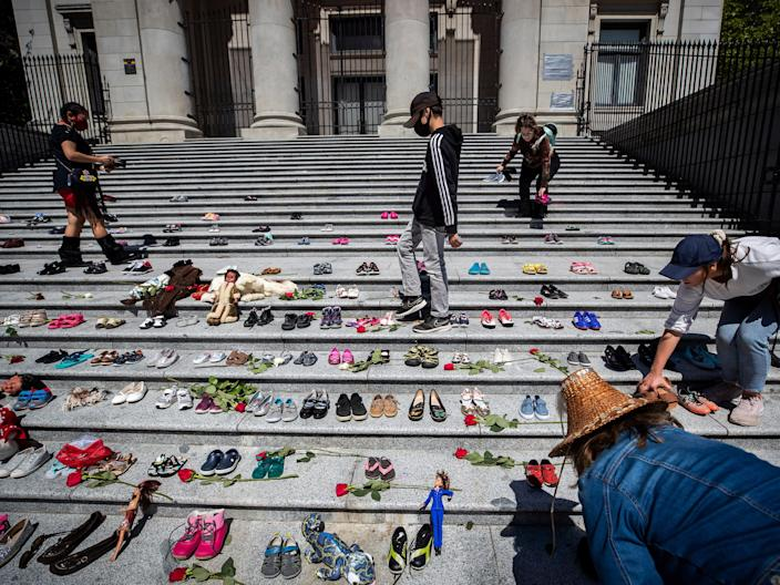 <p>More than 200 pairs of children's shoes have been placed on the steps of the Vancouver Art Gallery to pay tribute to those buried at the school site</p> (AP)