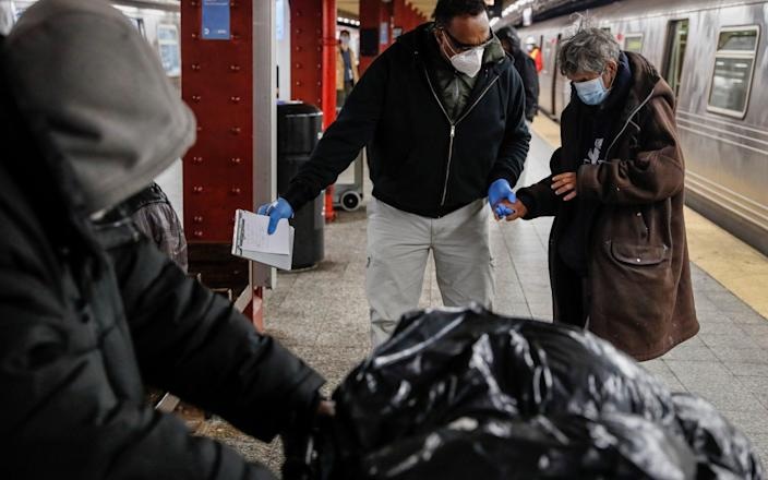 Homeless outreach work has been cut in the latest NYPD budget - AP
