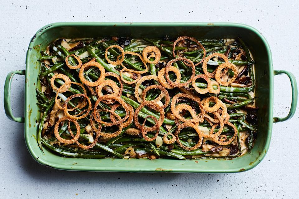 """A mix of wild mushrooms lends an earthy touch to this creamy classic, but it's the spice-spiked fried onions that will likely garner all the """"wows."""" <a href=""""https://www.epicurious.com/recipes/food/views/green-bean-and-mushroom-casserole-with-crispy-fried-onions?mbid=synd_yahoo_rss"""" rel=""""nofollow noopener"""" target=""""_blank"""" data-ylk=""""slk:See recipe."""" class=""""link rapid-noclick-resp"""">See recipe.</a>"""