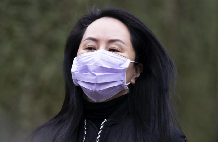 Chief Financial Officer of Huawei, Meng Wanzhou leaves her home in Vancouver, British Columbia, to go to the British Columbia Supreme Court on Friday, Jan. 29, 2021. (Jonathan Hayward/The Canadian Press via AP)