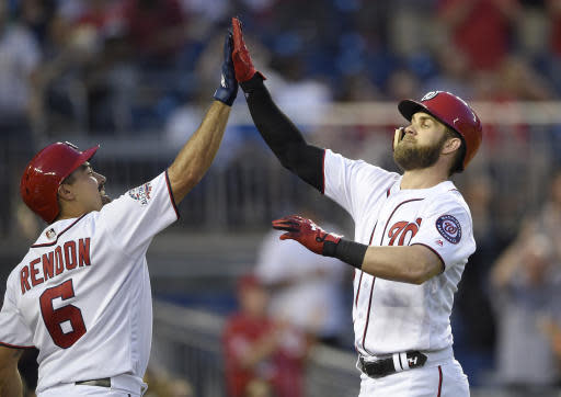 Washington Nationals' Bryce Harper, right, celebrates his home run with Anthony Rendon (6) during the fifth inning of a baseball game against the San Diego Padres, Monday, May 21, 2018, in Washington. (AP Photo/Nick Wass)