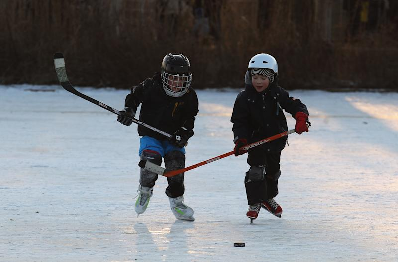 HAMBURG, GERMANY - FEBRUARY 10: kids play ice hockey on the frozen Aussenalster river during the 'Alstervergnuegen' on February 10, 2012 in Hamburg, Germany. The very popular annual city festival 'Alstervergnuegen' takes place around the Alster lake in Hamburg. Last time the Alster was official approved for the 'Alstervergnuegen' is 15 years ago.  (Photo by Joern Pollex/Getty Images)