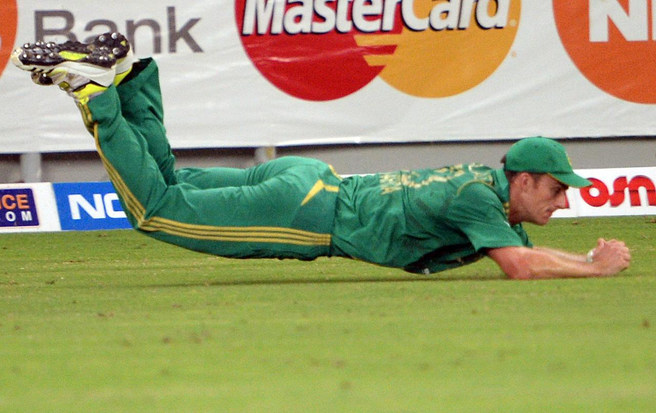 South African cricketer Ryan McLaren makes a successful catch of Pakistani batsman Shahid Afridi (unseen) during the First T20 International at Dubai stadium on November 13, 2013. Pakistan won the toss and elected to bat. AFP PHOTO/ ASIF HASSAN        (Photo credit should read ASIF HASSAN/AFP/Getty Images)