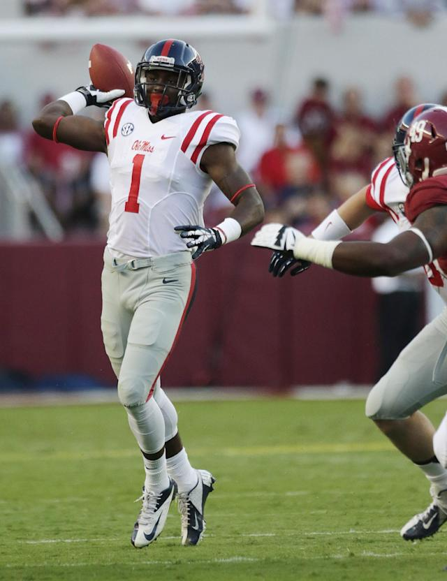 Mississippi wide receiver Laquon Treadwell (1) throws an interception as Alabama defensive lineman Ed Stinson (49) pursues during the first half of an NCAA college football game in Tuscaloosa, Ala., Saturday, Sept. 28, 2013. (AP Photo/Dave Martin)