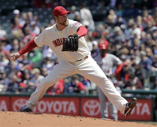Cleveland Indians starting pitcher Derek Lowe throws against the Los Angeles Angels in the second inning of a baseball game in Cleveland, Sunday, April 29, 2012. (AP Photo/Amy Sancetta)