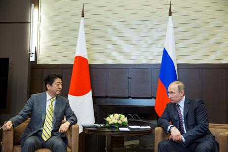 Russian President Vladimir Putin (R) meets with Japanese Prime Minister Shinzo Abe in Sochi, Russia, May 6, 2016. REUTERS/Pavel Golovkin/Pool/Files