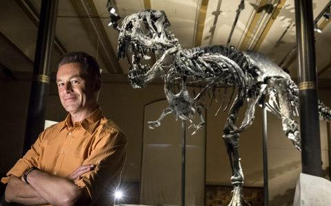 Chris Packham with Tristan the Tyrannosaurus Rex in Berlin at the Naturkundemuseum in Berlin - Credit: Gordon Welters