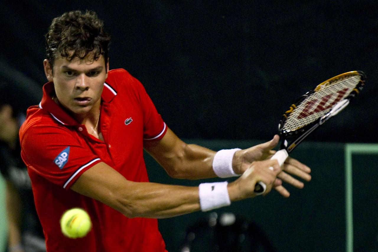 Canadian tennis player Milos Raonic sends the ball to Israel's Amir Weintraub during their Davis Cup match on September 16, 2011 at the Canada stadium in Ramat Hasharon, north of Tel Aviv. Israel is facing Canadian in the Davis Cup world group play-offs between September 16-18 in which the winners advance to World Group in 2012. AFP PHOTO/JACK GUEZ (Photo credit should read JACK GUEZ/AFP/Getty Images)