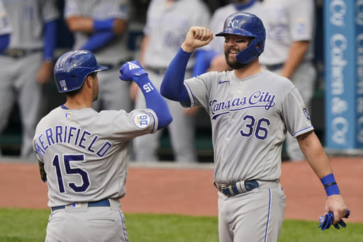 Kansas City Royals' Whit Merrifield (15) is congratulated by Cam Gallagher (36) after Merrifield hit a three-run home run during the third inning of the team's baseball game against the Cleveland Indians, Tuesday, Sept. 8, 2020, in Cleveland. (AP Photo/Tony Dejak)