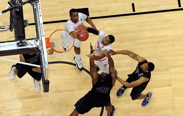 PITTSBURGH, PA - MARCH 17: Kris Joseph #32 and James Southerland #43 of the Syracuse Orange reach for a rebound against Thomas Gipson #42 of the Kansas State Wildcats during the third round of the 2012 NCAA Men's Basketball Tournament at Consol Energy Center on March 17, 2012 in Pittsburgh, Pennsylvania. (Photo by Gregory Shamus/Getty Images)
