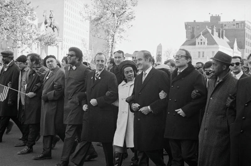 (Original Caption) Marching in the antiwar parade down Pennsylvania Avenue, are left to right: Senator Charles Goodell, (R-N.Y.), Mrs. Coretta Scott King, and Senator George S. McGovern, (D-S.D.). All three would address a rally at the Washington Monument following the mass march.