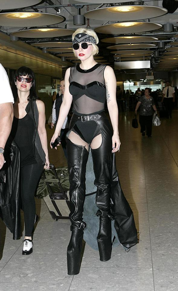 """Not to be harsh, but Lady Gaga got what she deserved when she fell to the ground three seconds after this picture was snapped. Sky-high platform heels are not only distasteful, they're dangerous! <a href=""""http://www.infdaily.com"""" target=""""new"""">INFDaily.com</a> - June 23, 2010 <a href=""""http://www.infdaily.com"""" target=""""new"""">INFDaily.com</a> - June 23, 2010"""