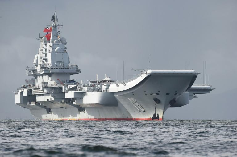 China's sole aircraft carrier, the Liaoning, took part in military drills Friday, the Chinese navy said, ramping up tensions with Taiwan