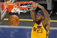 Utah Jazz forward Royce O'Neale (23) dunks against the San Antonio Spurs in the first half during an NBA basketball game Monday, May 3, 2021, in Salt Lake City. (AP Photo/Rick Bowmer)