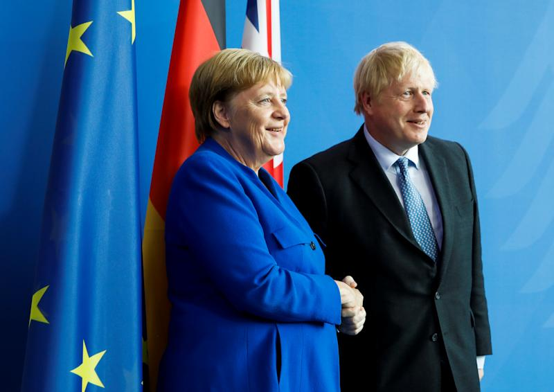 Britain's Prime Minister Boris Johnson and German Chancellor Angela Merkel shake hands as they pose for a photo during a news conference at the Chancellery in Berlin, Germany, August 21, 2019. REUTERS/Axel Schmidt