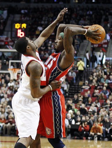 Portland Trail Blazers' Wesley Matthews, left, defends against New Jersey Nets' Gerald Wallace, right, in the first quarter of an NBA basketball game, Wednesday, April 4, 2012, in Portland, Ore. (AP Photo/Rick Bowmer)