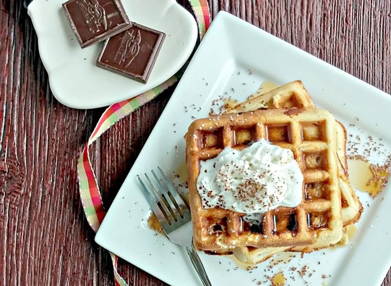 plate of belgian waffles with peanut butter dark chocolate whipped cream