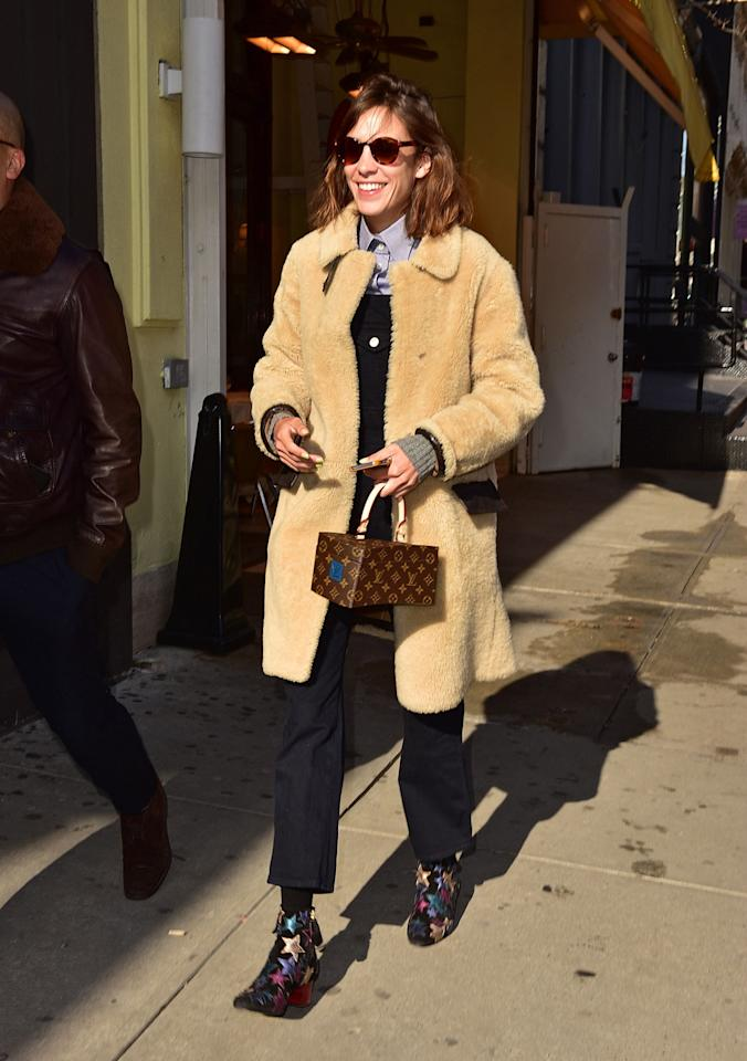 <p>Sorry, Paddington — Alexa Chung might be the most stylish teddy bear we've ever seen in her fuzzy coat, rainbow star booties, and boxy Louis Vuitton logo tote. Sometimes, more <i>is</i> more. </p>