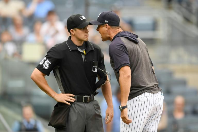 New York Yankees manager Aaron Boone argues with plate umpire Brennan Miller in a game against Tampa Bay, an outburst that earned Boone a one-game suspension by Major League Baseball