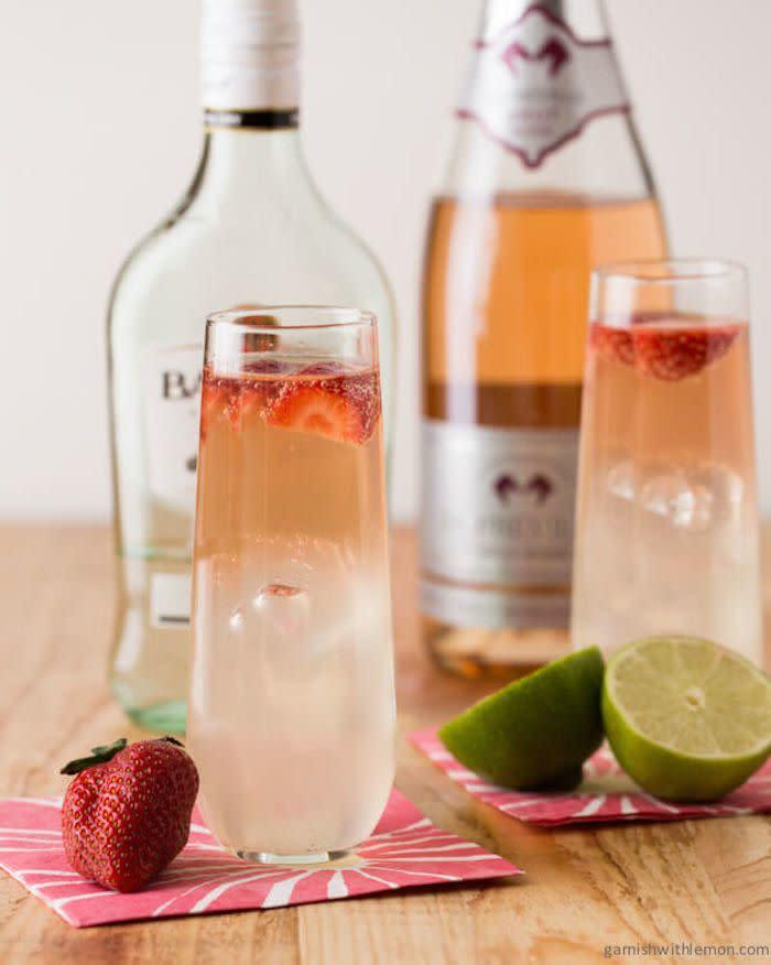 <strong>Get the <span>Bubbly Strawberry Mojitos recipe </span>from Garnish With Lemon</strong>