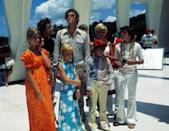 """<p><strong>""""Hawaii Bound,"""" """"Pass the Tabu,"""" """"The Tiki Caves"""" (1972)</strong><br><br>The '70s sitcom featured episodes filmed on location at the Grand Canyon and Kings Island theme park, but the three-parter set in Hawaii was the ultimate Brady vacation. Mike Brady's employer footed the bill for the all-inclusive trip (for a family of eight plus their housekeeper???), but things went downhill from there when Alice threw out her back during a hula lesson and Peter was stalked by a poisonous spider. Even more terrifying, Greg almost lost his life in a surfing accident, but on the plus side we got Vincent Price, a Don Ho serenade, and a groovy tiki idol souvenir.<br><br>(Photo: Everett Collection) </p>"""