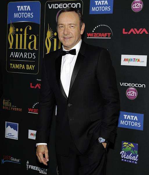 Actor Kevin Spacey poses for photographers as he walks the green carpet after arriving for 15th annual International Indian Film Awards Saturday, April 26, 2014, in Tampa, Fla. (AP Photo/Chris O'Meara)