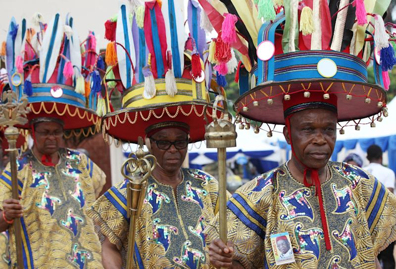 "Traditional Igbo chiefs attend the funeral of late author Chinua Achebe in Ogidi, Nigeria, Thursday, May 23, 2013. Writer Chinua Achebe is being remembered in Nigeria as a fearless writer who bowed to no political pressure, as mourners gather in his hometown for a funeral Thursday. Among attendees was Nigerian President Goodluck Jonathan, who held up copies of Achebe's books during the service at a local Anglican church — including his famous essay ""The Trouble With Nigeria"" and Ghanaian President John Mahama. (AP Photo/Sunday Alamba)"