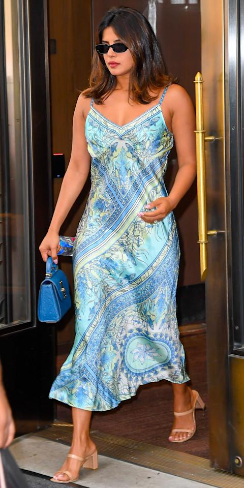 """<p>Priyanka Chopra's <a href=""""https://www.halebob.com/shop/zaneta-stretch-silk-dress-blue-con"""">Hale Bob silk slip dress</a> is the perfect one-and-done style solution for warmer days. All she needed were those black Le Specs shades ($79;<a href=""""https://click.linksynergy.com/deeplink?id=93xLBvPhAeE&mid=42352&murl=https%3A%2F%2Fwww.shopbop.com%2Funreal-sunglasses-le-specs%2Fvp%2Fv%3D1%2F1528809840.htm&u1=IS%2CLOTD072519-Priyanka-Embed%2Ckchiello1271%2C%2CIMA%2C3467468%2C201907%2CI"""" target=""""_blank"""">shopbop.com</a>), a small Ferragamo bag, and sand-colored By FAR sandals ($385; <a href=""""https://click.linksynergy.com/deeplink?id=93xLBvPhAeE&mid=24449&murl=https%3A%2F%2Fwww.net-a-porter.com%2Fus%2Fen%2Fproduct%2F1136664&u1=IS%2CLOTD072519-Priyanka-Embed%2Ckchiello1271%2C%2CIMA%2C3467468%2C201907%2CI"""" target=""""_blank"""">net-a-porter.com</a>) to complete her breezy (and easy) summer outfit.</p>"""