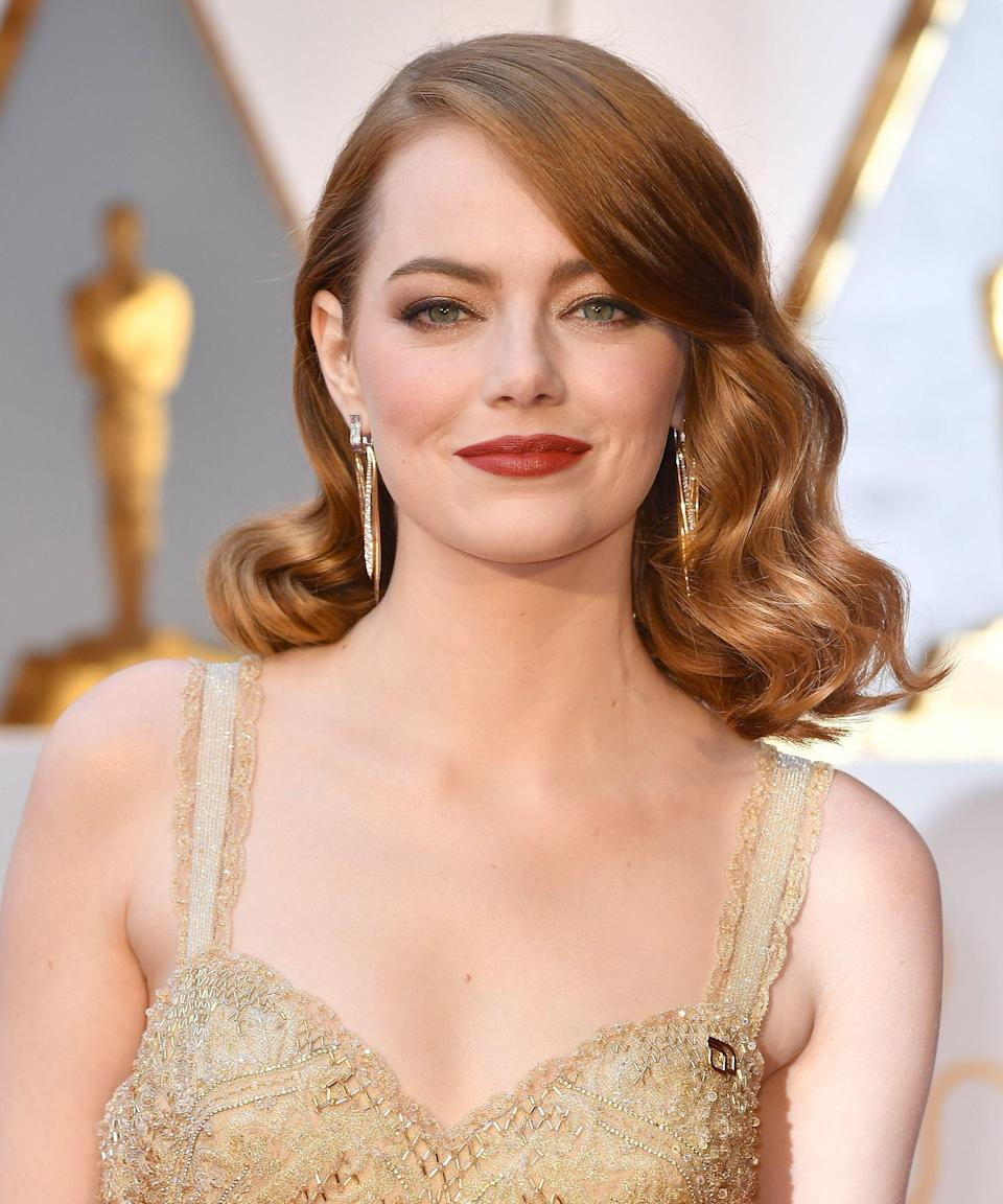 """<p><strong>Emma Stone, 2017</strong></p><p>When you're up for the biggest award in your field — and countless photographers will be taking your picture — it's about landing on a hairstyle that looks modern, yet feels timeless. Stone's stylist <a href=""""https://www.instagram.com/mararoszak/?hl=en"""" rel=""""nofollow noopener"""" target=""""_blank"""" data-ylk=""""slk:Mara Rozak"""" class=""""link rapid-noclick-resp"""">Mara Rozak</a> created a deep-cut lob that was both a nod to '30s Hollywood glamour and a style we all wanted to bookmark for later.</p><span class=""""copyright"""">Photo: Jeff Kravitz/WireImage.</span>"""