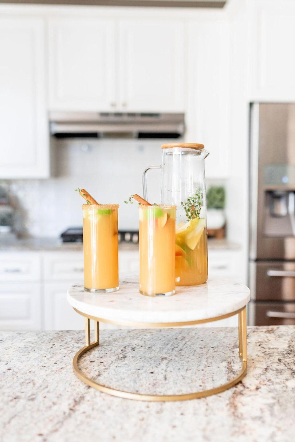"""<p>You'll want to have this autumnal sangria by your side all fall long. Depending on how you're feeling, there are virgin and non-virgin instructions.</p><p><strong>Get the recipe at <a href=""""https://www.rosalynndaniels.com/easy-apple-cider-sangria-recipe/"""" rel=""""nofollow noopener"""" target=""""_blank"""" data-ylk=""""slk:Rosalynn Daniels"""" class=""""link rapid-noclick-resp"""">Rosalynn Daniels</a>.</strong></p><p><strong><a class=""""link rapid-noclick-resp"""" href=""""https://www.amazon.com/Youngever-Plastic-Pitcher-Sangria-Lemonade/dp/B08XSP76FS/?tag=syn-yahoo-20&ascsubtag=%5Bartid%7C2164.g.36792938%5Bsrc%7Cyahoo-us"""" rel=""""nofollow noopener"""" target=""""_blank"""" data-ylk=""""slk:SHOP PITCHERS"""">SHOP PITCHERS</a><br></strong></p>"""