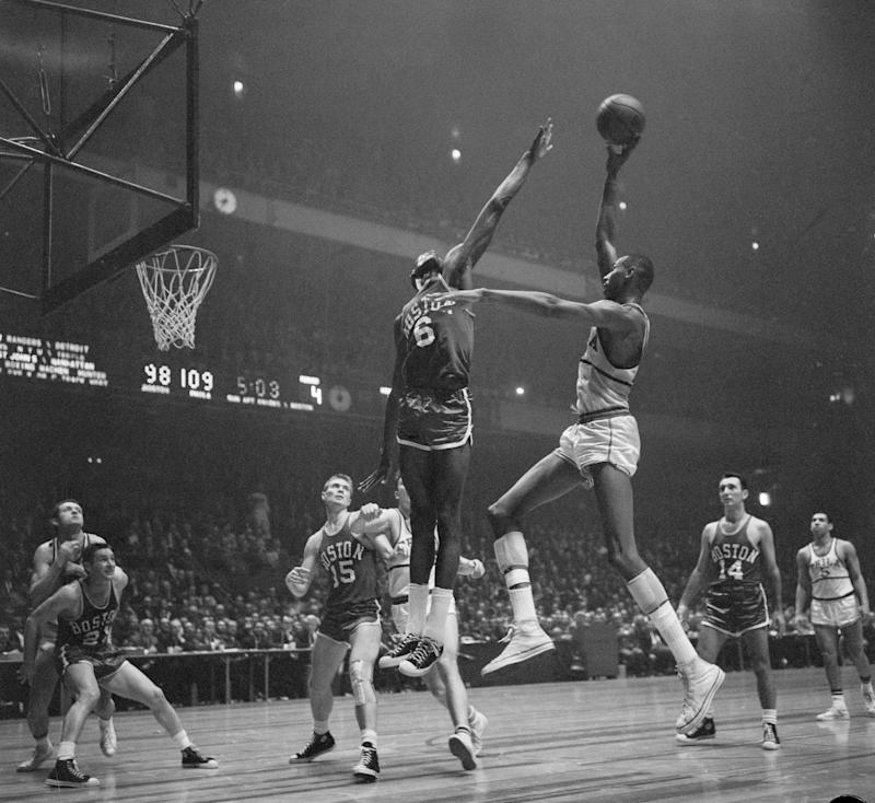 Bill Russell (6) of Boston in on action as Wilt Chamberlain (13) of Philadelphia misses basket.
